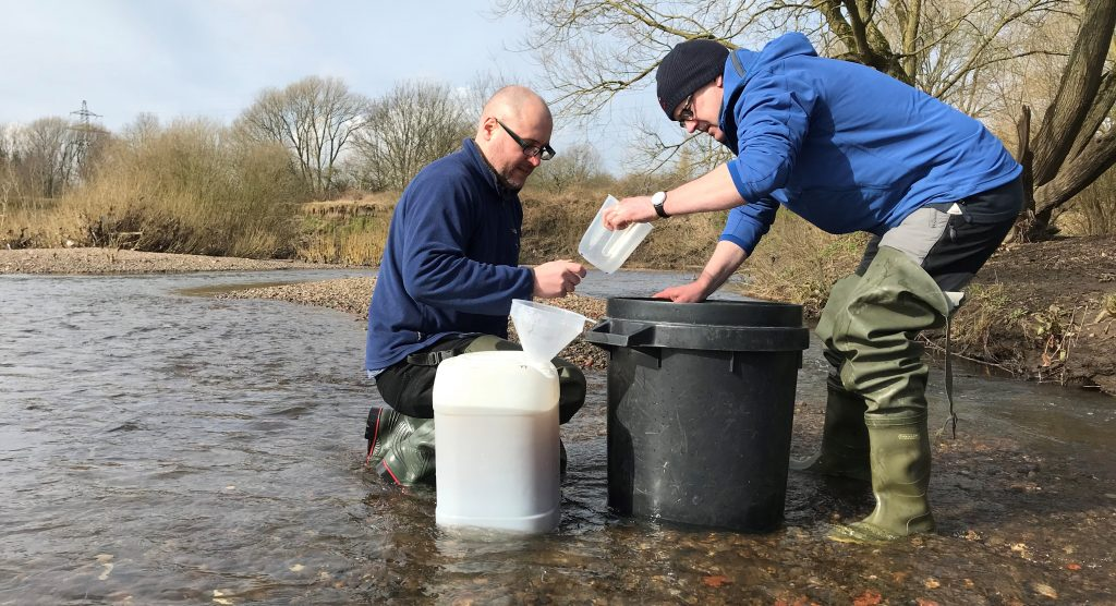 Researchers sampling freshwater for microplastics Photo: Manchester University