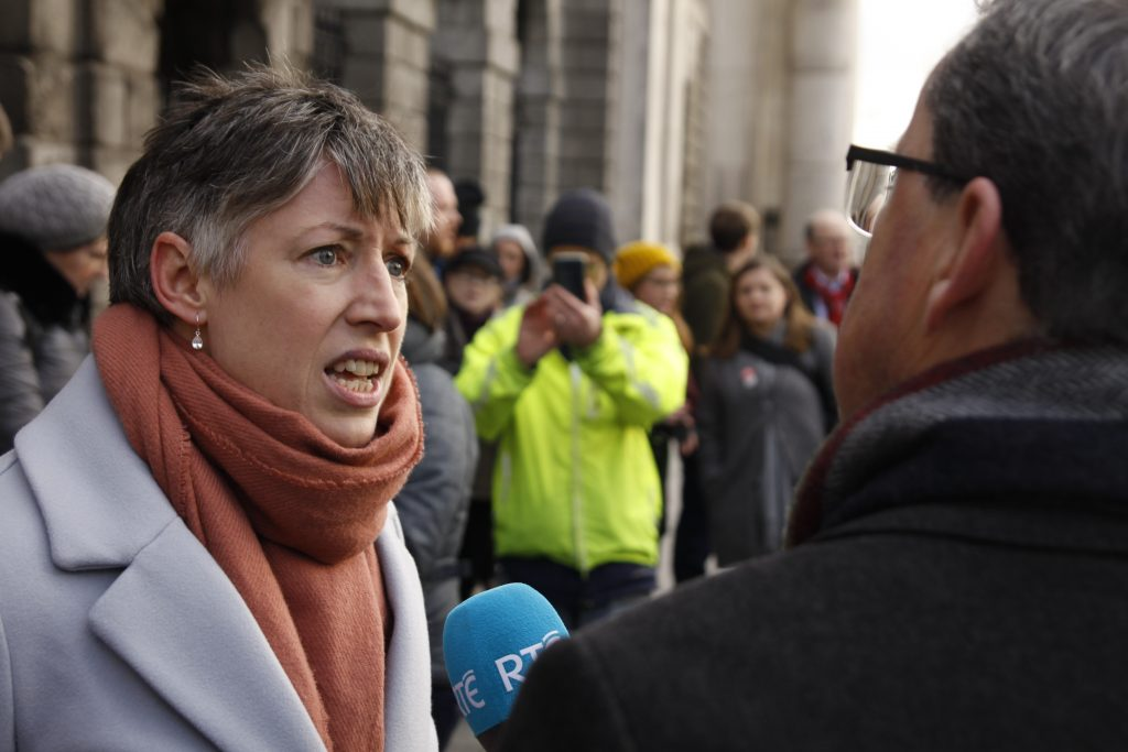 Sadhbh O'Neill of FiE addressing media at the High Court Photo: Niall Sargent