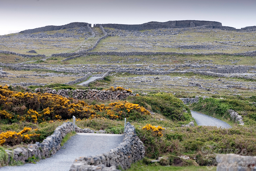 Dun Aonghasa Fort, Inis Mór, Aran Islands, County Galway, Ireland. The island of Inis Mór ( meaning the big island) is one of the most popular tourist destinations in Ireland. The islands inland landscape of uniquely blanketed rock surface are glazed with man made rock walls that meander and cross all directions as far as one can see. Well known internationally, it is steeped in history and resembles an outdoor museum with over 50 different monuments of Christian, pre Christian and Celtic mythological heritage. Picture James Horan
