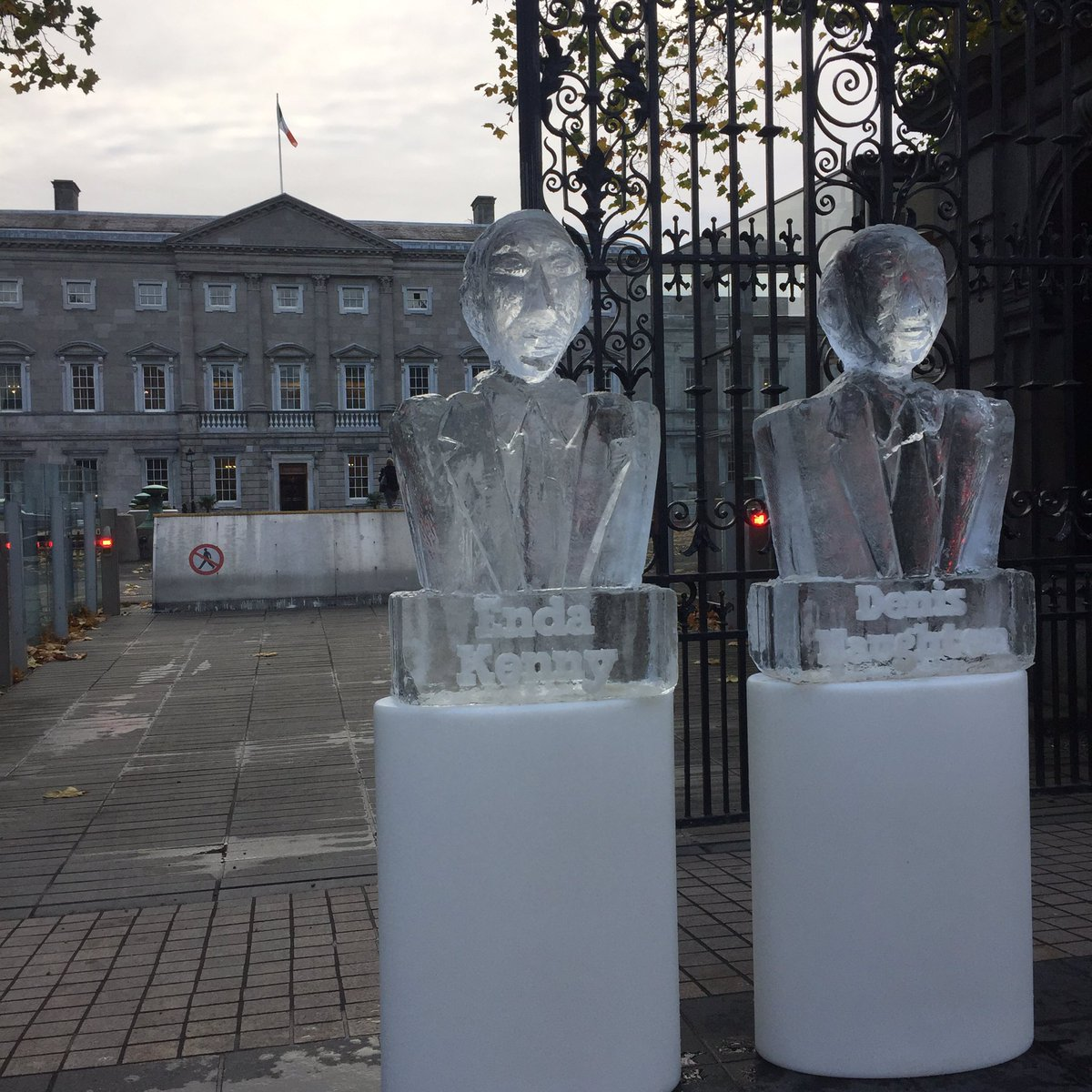 Environmental action group stage climate-change performance art - Melting ice busts of Taoiseach Enda Kenny and Minister Denis Naughten - for meet you TD today