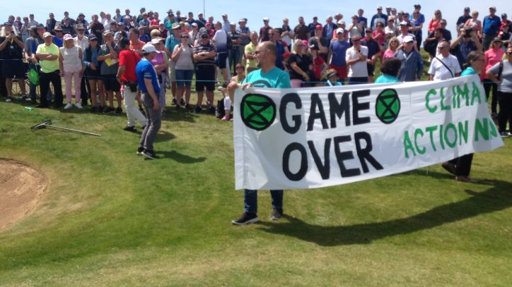 action by Extinction Rebellion Clare, in which they unfurled a large banner during the first day of the Irish Open Golf tournament