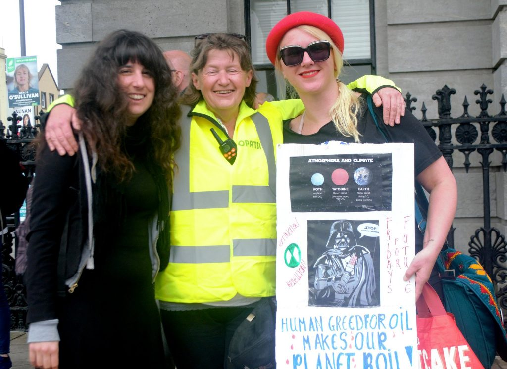 Tjitske de Vries (R) with  Noreen Murphy (C) and Martina Evans (L) at a climate rally in Cork pic Shamim Malekmian